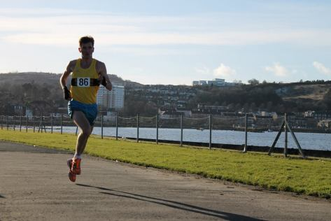 Derek Hawkins won the gold medal in a new course record of 23:42