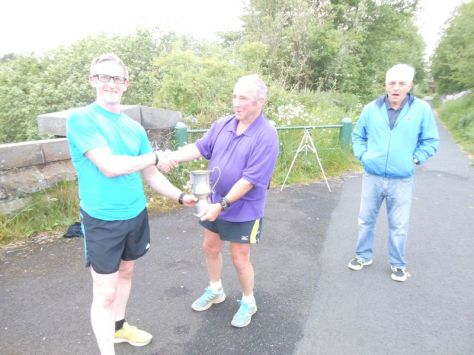 Norman Groves presented the trophy by last years winner Max McFarlane