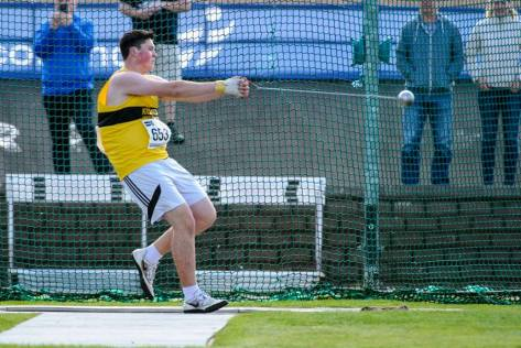 Andrew Costello swings for GOLD in the Hammer (photo by Bobby Gavin)