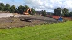 Diggers levelling the ground for the indoor facility